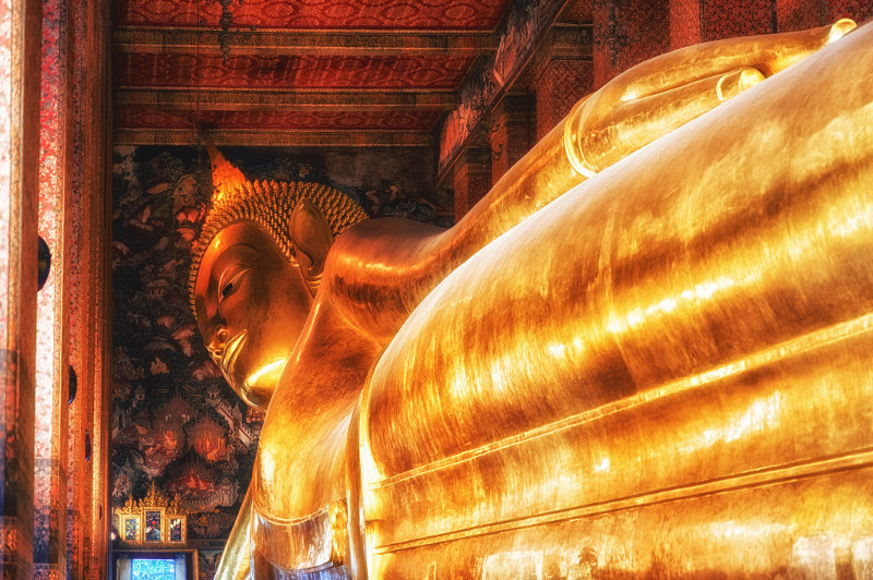 A view of the golden reclining Buddha at Wat Pho in Bangkok, Thailand.