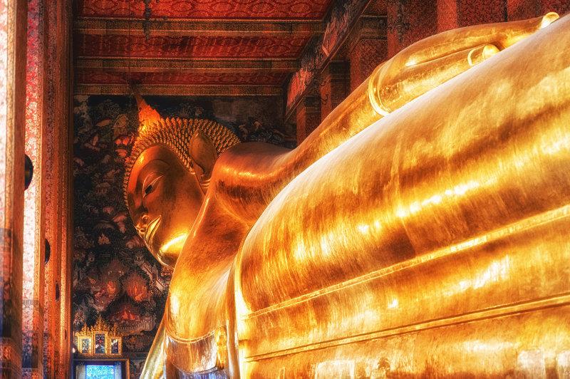 A view of the golden reclining Buddha at Wat Pho in Bangkok, Thailand.