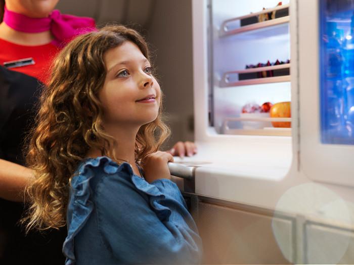 young girl onboard qantas plane