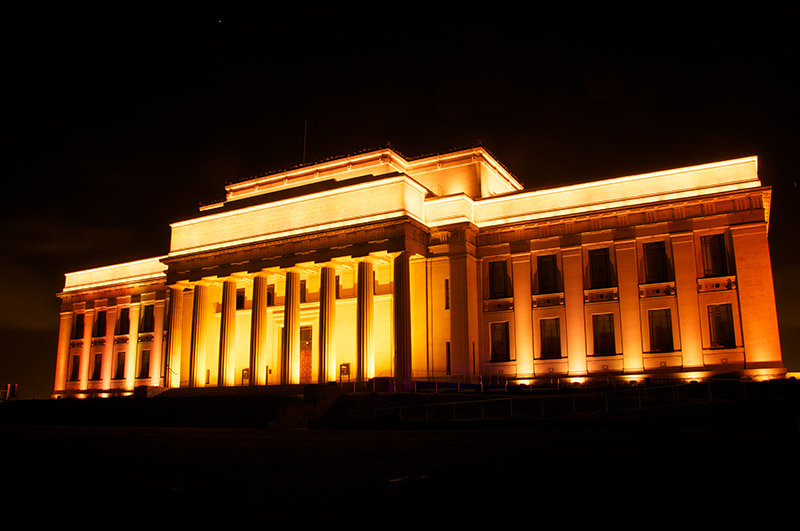 Auckland museum at night lit up by lights
