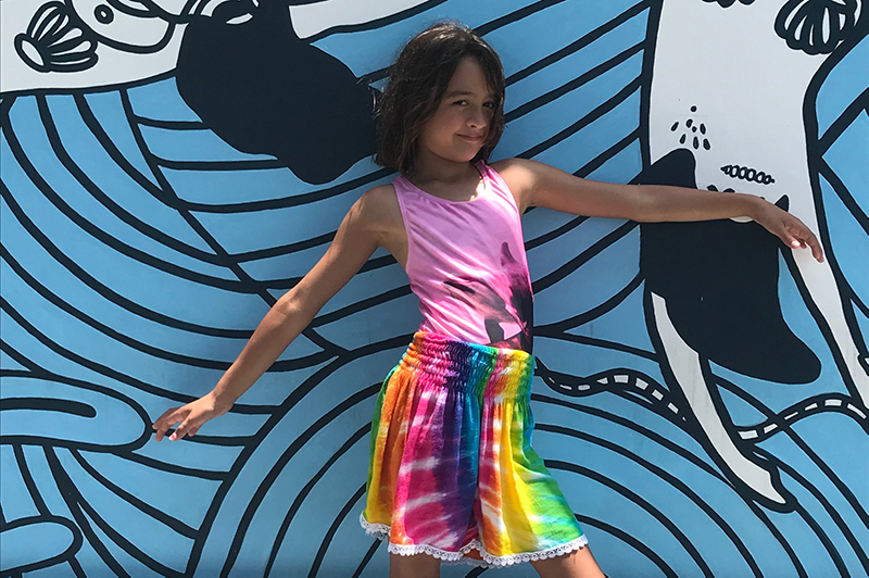 Girl in front of mural in Canggu.
