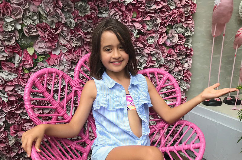 Girl in chair in front of Seminyak shop