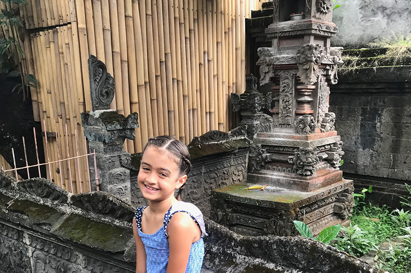 Girl in front of Bali shrine