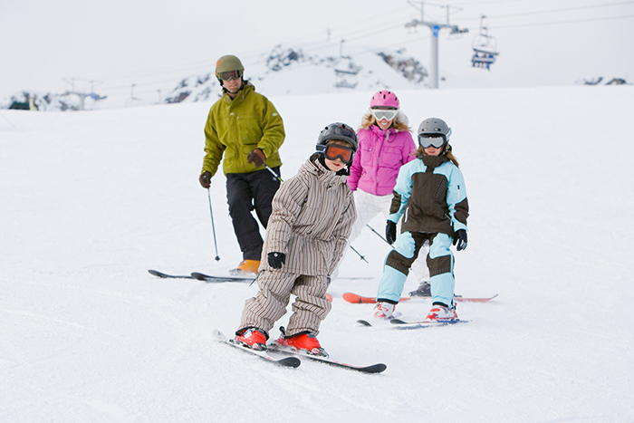 A family skis down the slopes together at Whistler Blackcomb