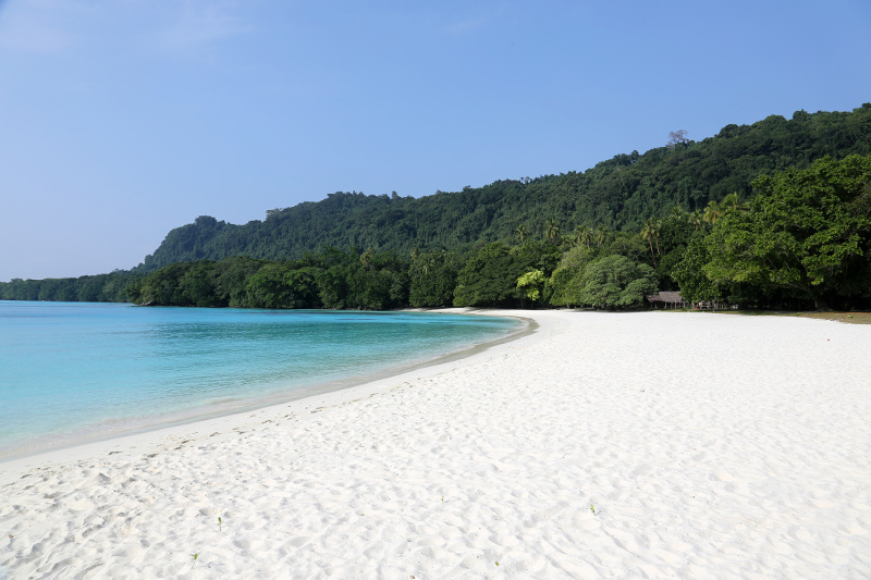 The white sand, turquoise waters and jungle-covered hills of Champagne Beach in Vanuatu.