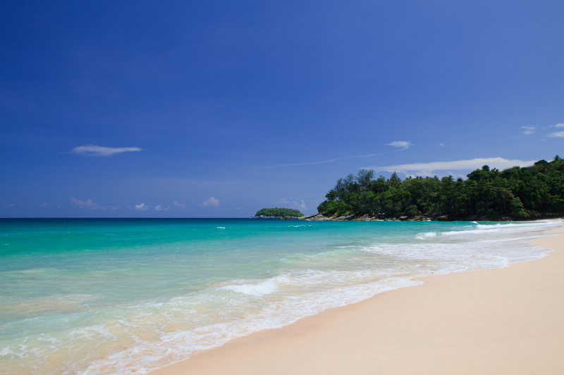 White sand, turquoise waters and a jungle backdrop at Kata Noi Beach in Phuket, Thailand.