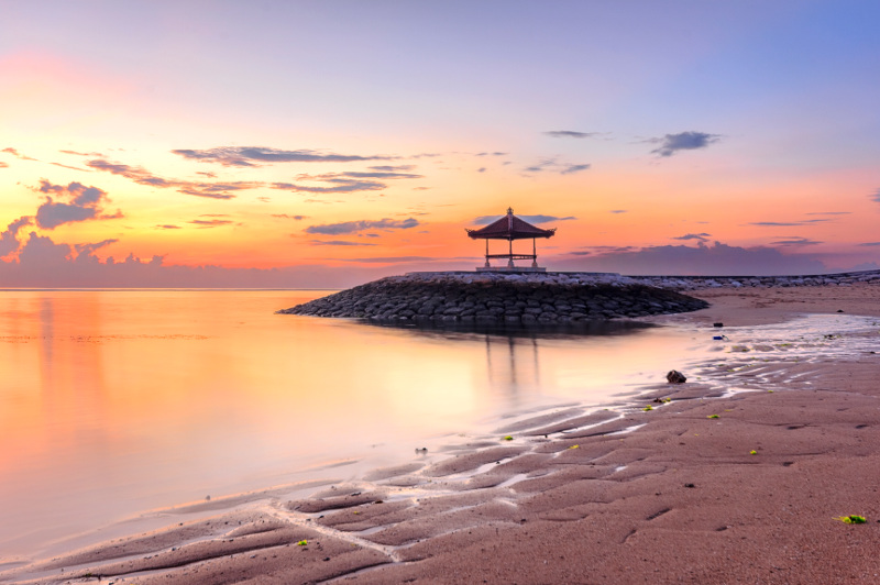 A Balinese pagoda graces the shore at Sanur Beach. Image: Getty