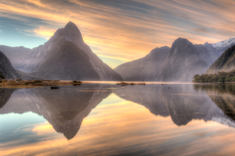 Morning casts pastel reflections in Milford Sound.