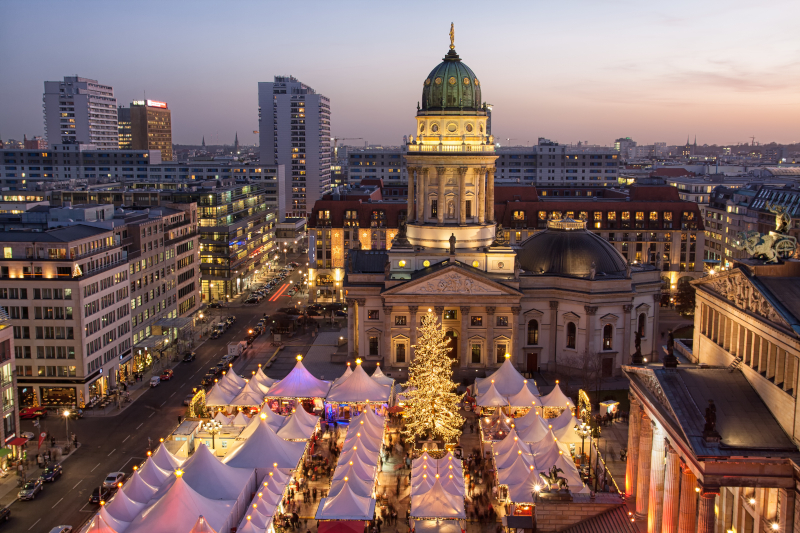 Aerial view of the Christmas Market at Gendarmenmarkt in Berlin. The sun is just setting