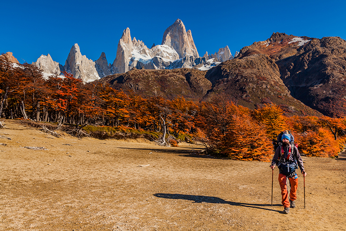 A walker in the foreground with El Chatan peak in the background in Patagonia