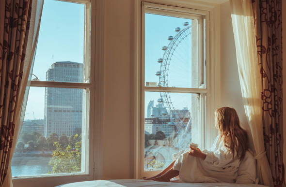 A view of the London Eye through the window of the Royal Horseguards London, England.