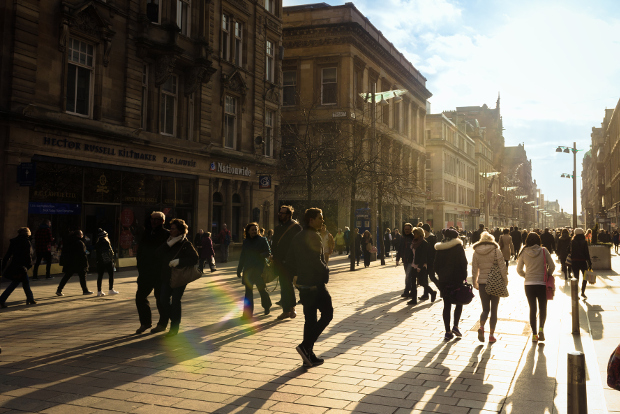 Shoppers walking down Buchanan Street at sunset