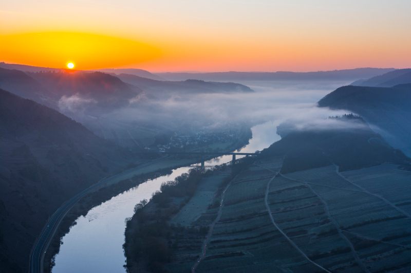 Sunset over the Moselle River in Germany.