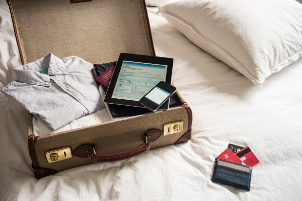 A packed suitcase open on a bed