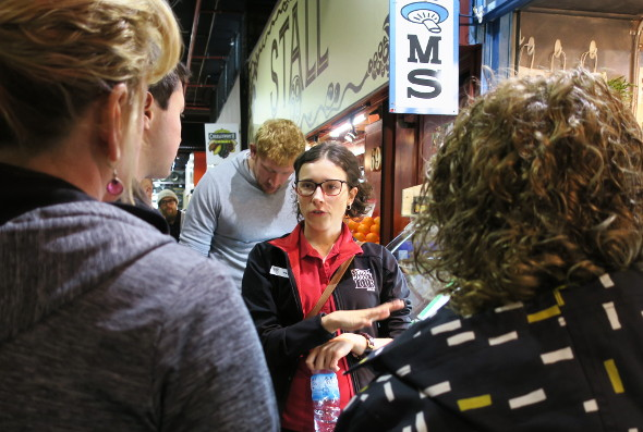 Tour guide gives spiel at Adelaide Central Market mushroom stall