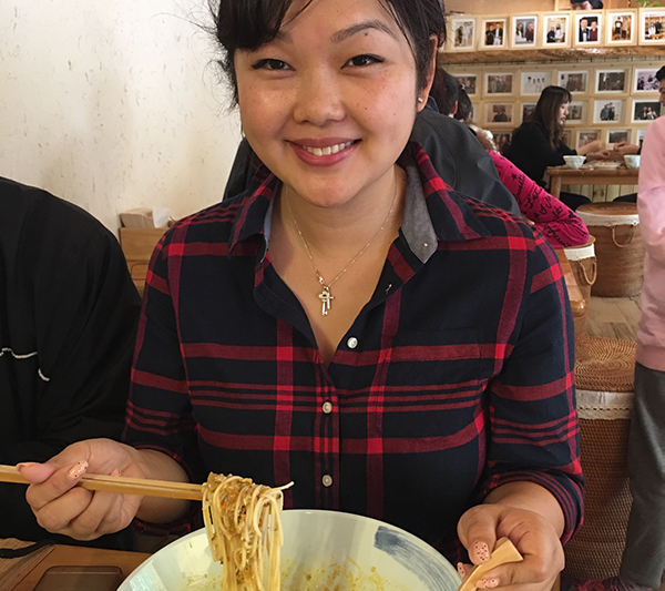 Woman with hairy crab roe noodles