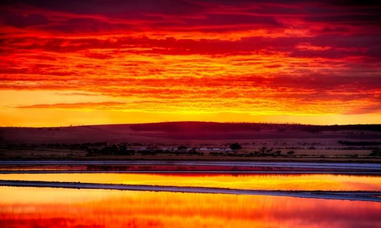 River reflecting colourful sunset