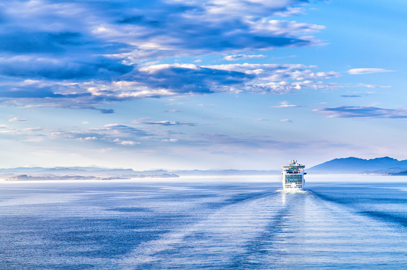 A cruise ship disappears into the distance.