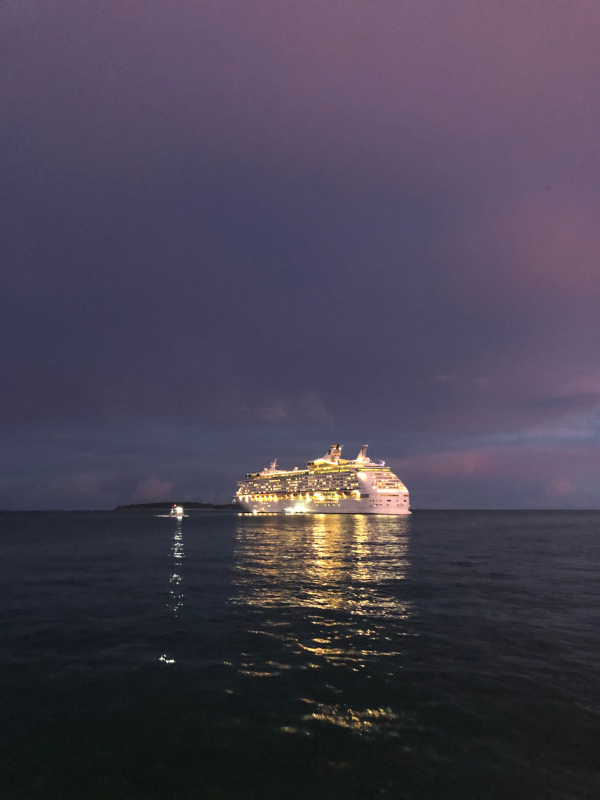 Cruise ship anchored out in the ocean by dusk