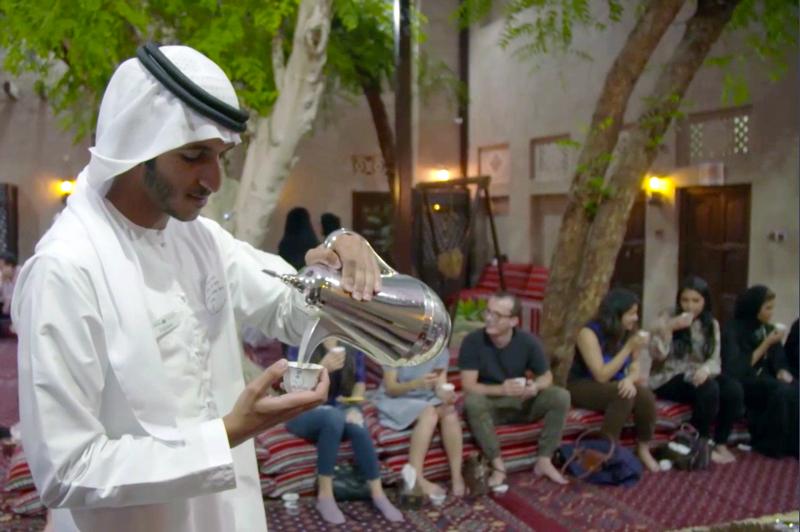 Arab man pouring tea