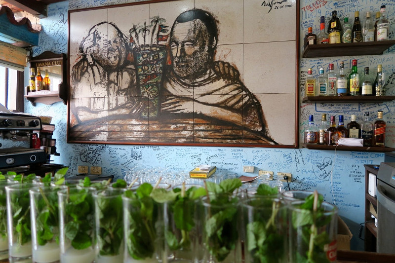 A striking artwork dominates one wall of a cafe in Cuba.