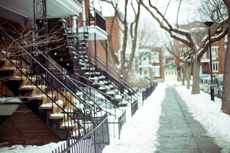 Staircases of Montreal's terrace houses are covered in snow.