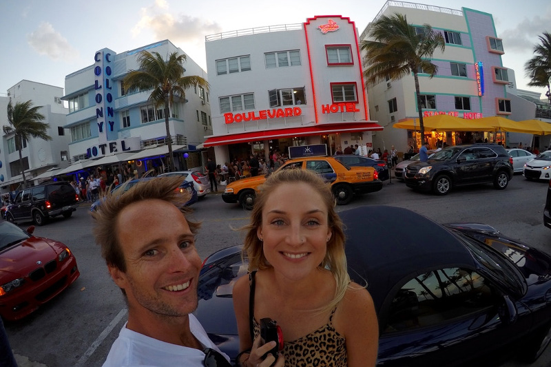 Nick and Meg Wall with the Art Deco hotels of Miami Beach in the background.