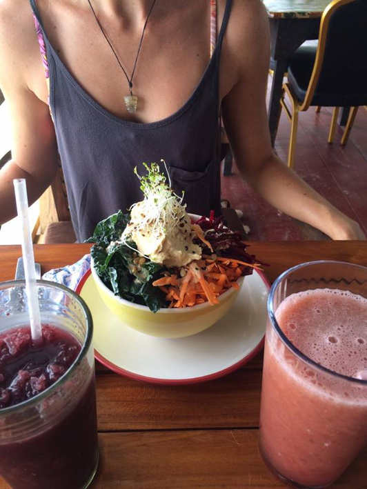 A woman enjoys fresh salads and juices at a cafe in Panama.