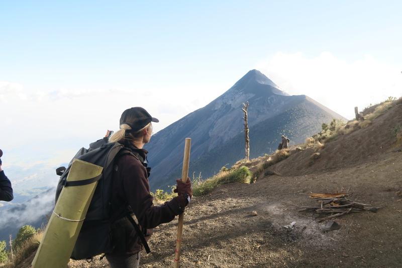 A woman climbs Acatenango volcano in Guatemala.