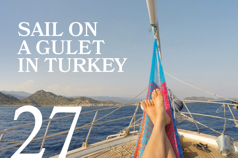 feet up in a hammock on a sail boat