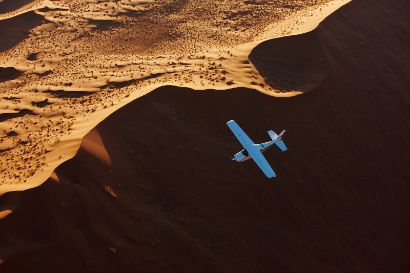 Plane flying over dunes in Namibia.