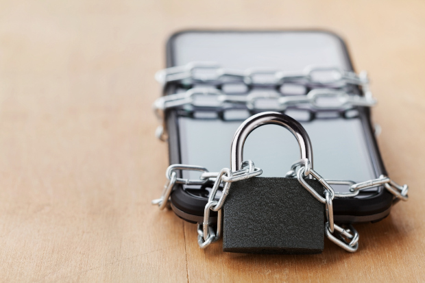 A phone wrapped in a chain and padlock