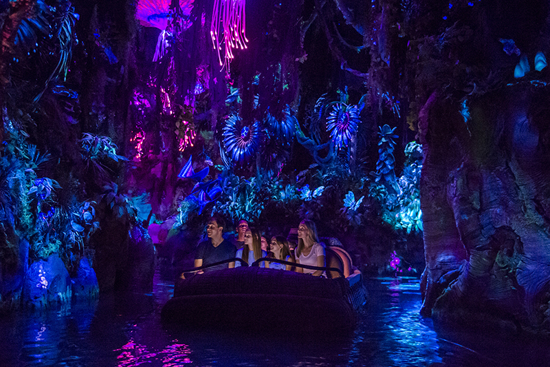 guests cruise through the na'vi river on the pandora ride at walt disney world