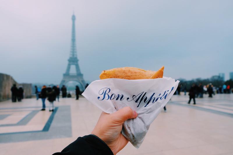 Eating french food near Eiffel Tower.