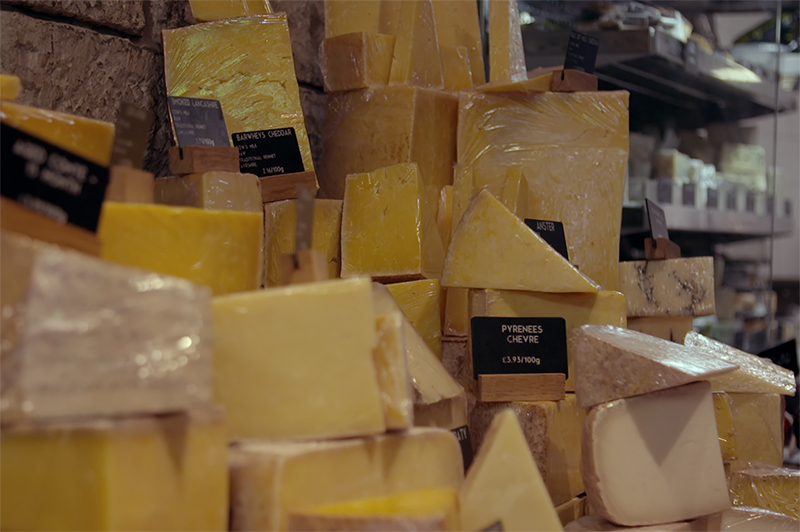 Different cheeses on display at a cheesemonger.