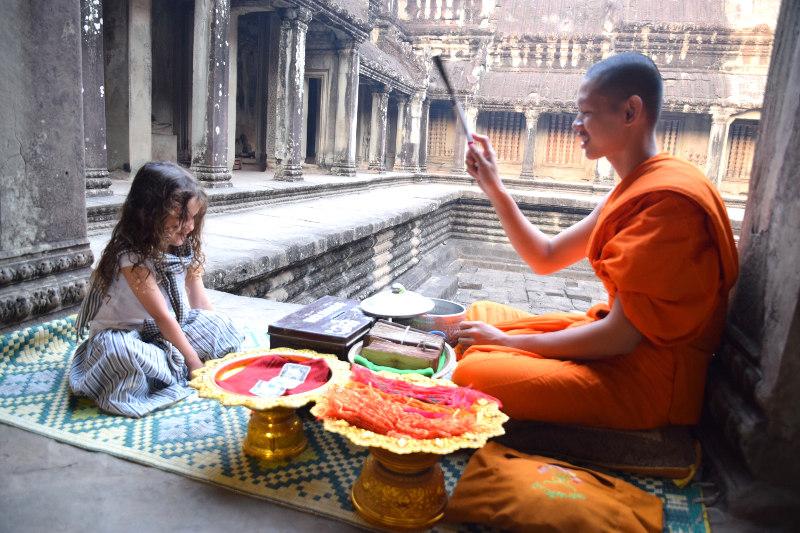 Buddhist blessing at Angkor Wat.