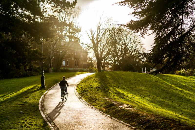Boy cycling in Parc des Buttes-Chaument, Paris.
