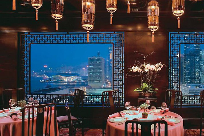 Beautiful interior and windows looking out onto Hong Kong skyline.