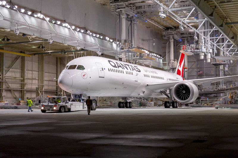 Qantas' Dreamliner rolling out of the Seattle Boeing factory, where over 700 staff work to output one single aircraft