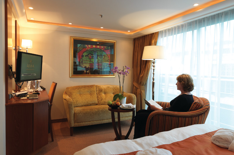 woman sitting in river cruise boat suite