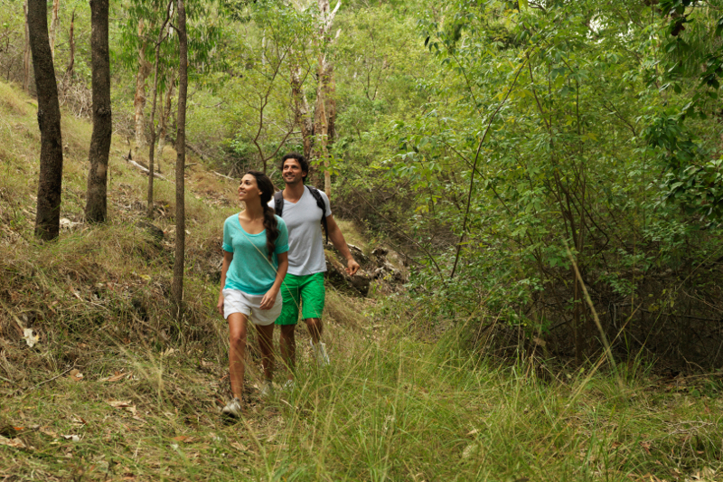Two walkers going on a bushwalk on Hamilton Island.