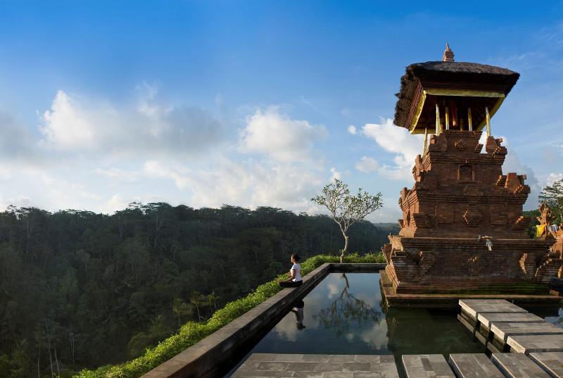 Zen Capital Of Bali: Woman  admiring view over Bali valley.