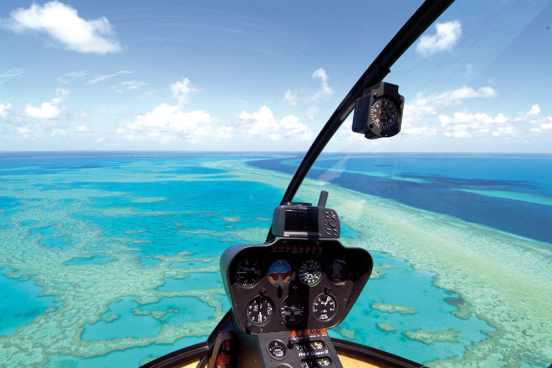 The view out over Hamilton Island from a helicopter high above.