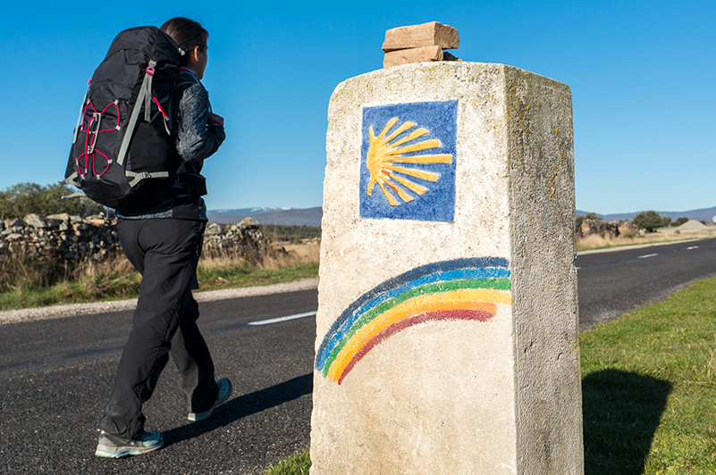 Woman walking on the El Camino de Santiago trail