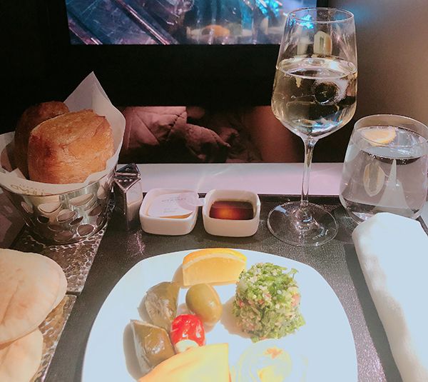 Meal and seatback screen in business class cabin