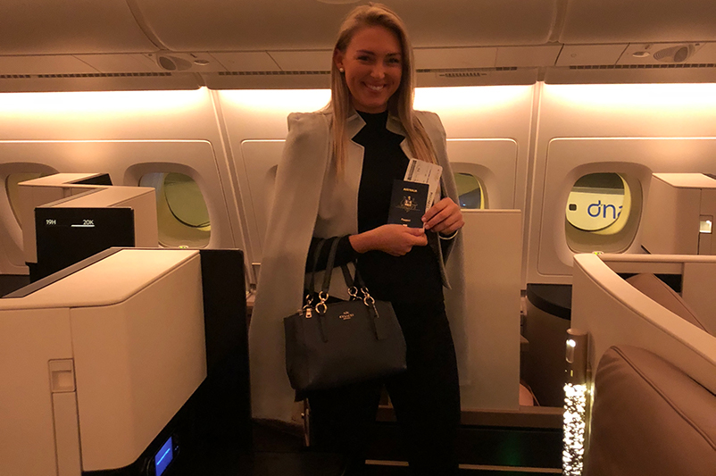 A female stands in Business Class Cabin on Etihad Airways