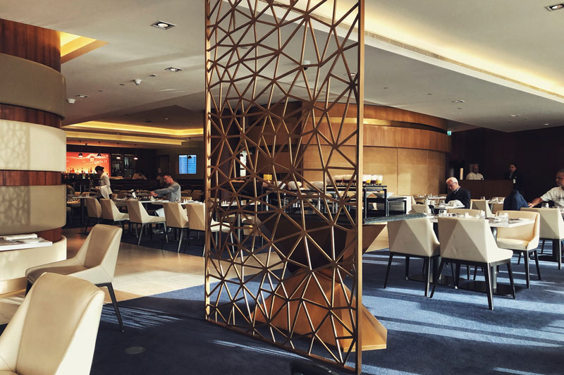 The light-filled dining area within the first class lounge in Abu Dhabi