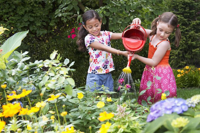 Girls watering garden