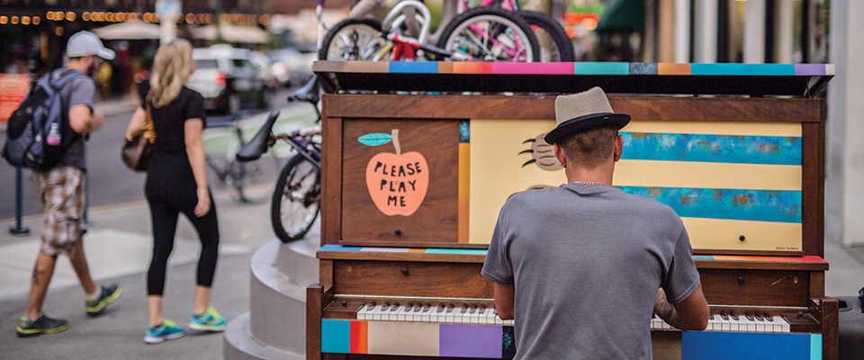 Man playing piano in street, Portland, Oregon