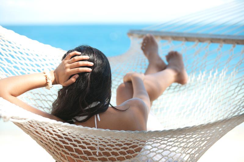 A woman lazes in a hammock in Fiji.